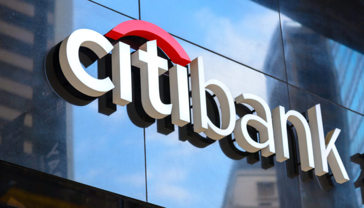 Citibank sign displayed on glass office building